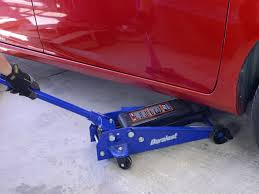 remove the jack stands to lower the wheels.